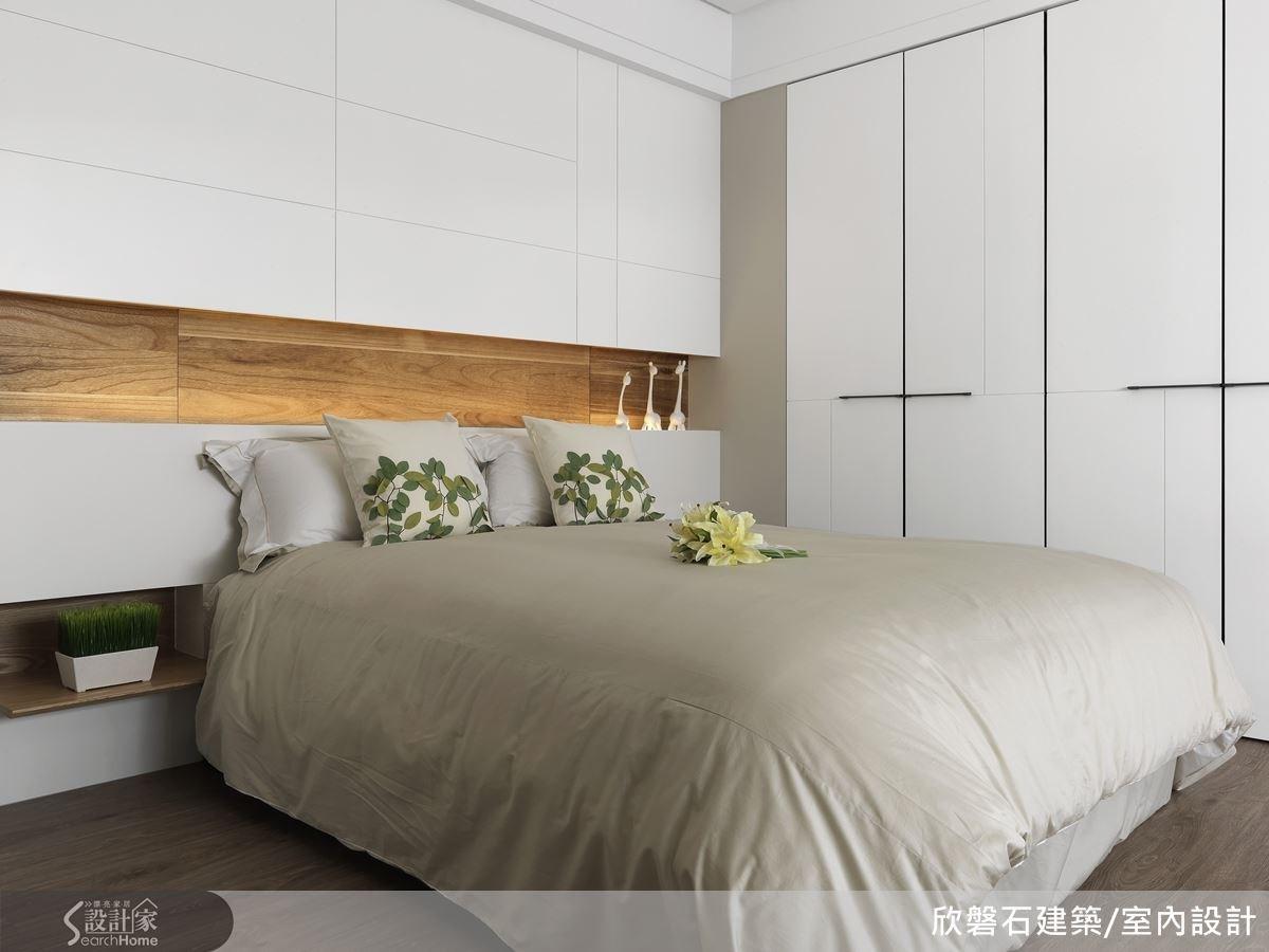 隱藏式的櫃體規劃讓臥房的收納變得美觀而乾淨。