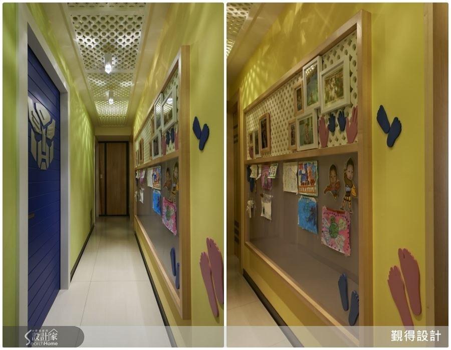 長形的廊道空間,在設計師的巧思下,可以掛上相片、小孩的畫作作品,成為充滿美好回憶的藝文長廊。