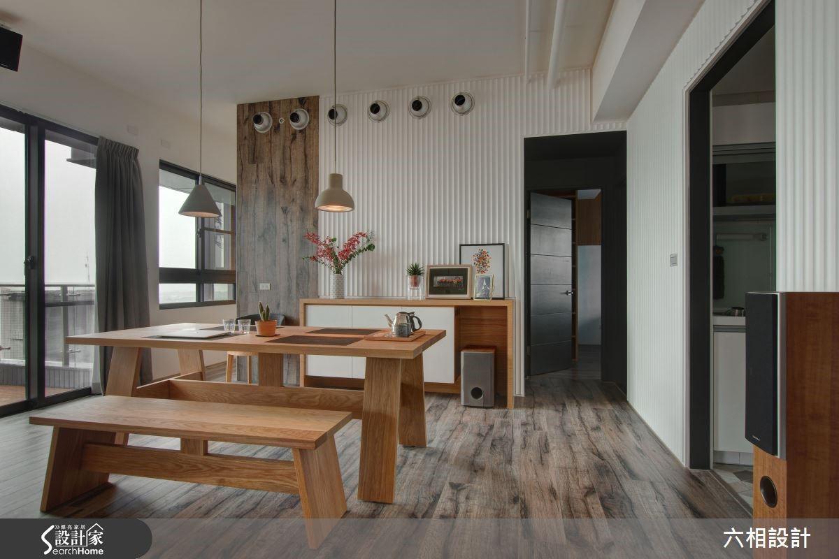 餐廳牆面的六個圓形出風口是造型與機能的創意結合,讓空間的設計質感更加強烈。