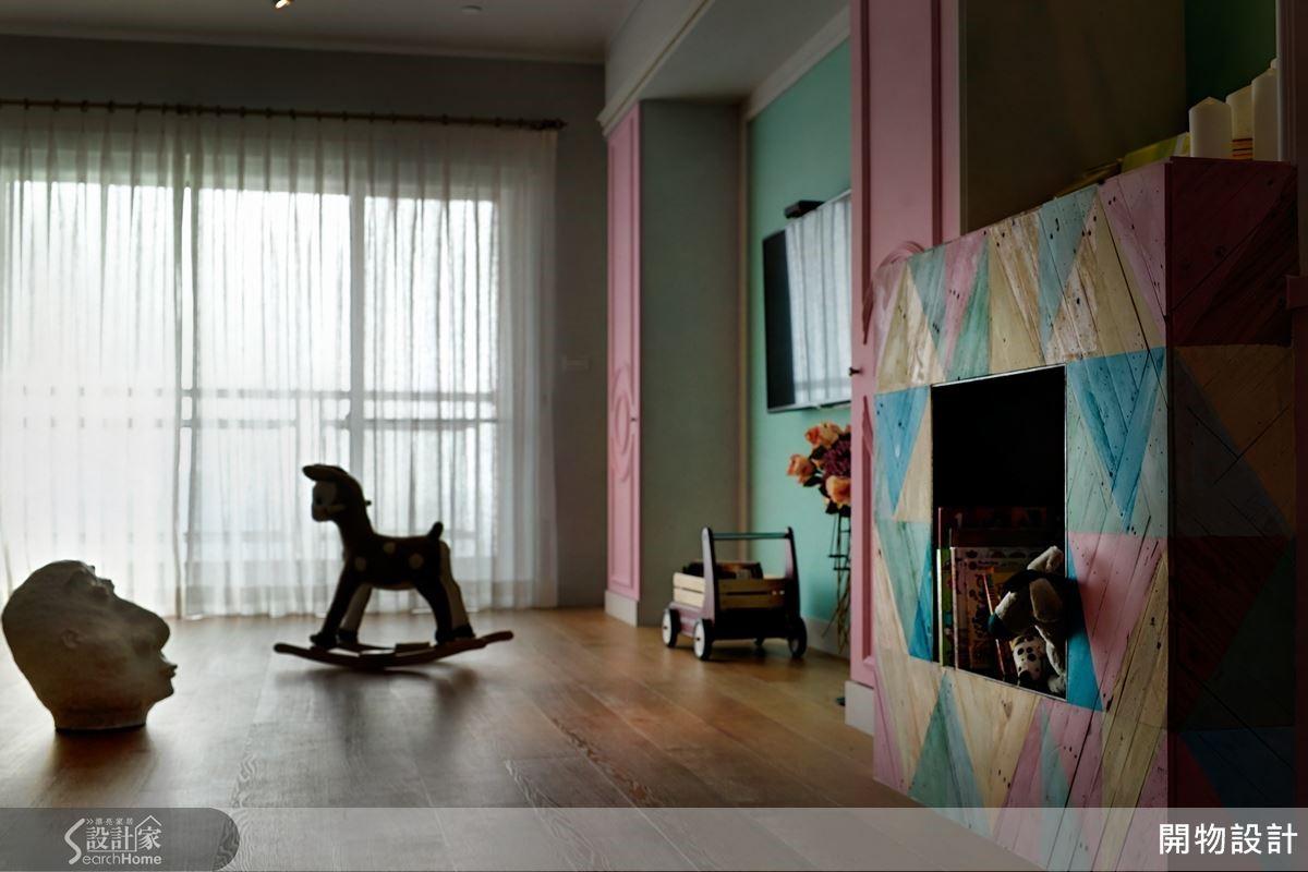 客廳融入手作藝品概念,替空間加入感情,壁爐採用回收木棧板錯色處理,充滿手感況味。