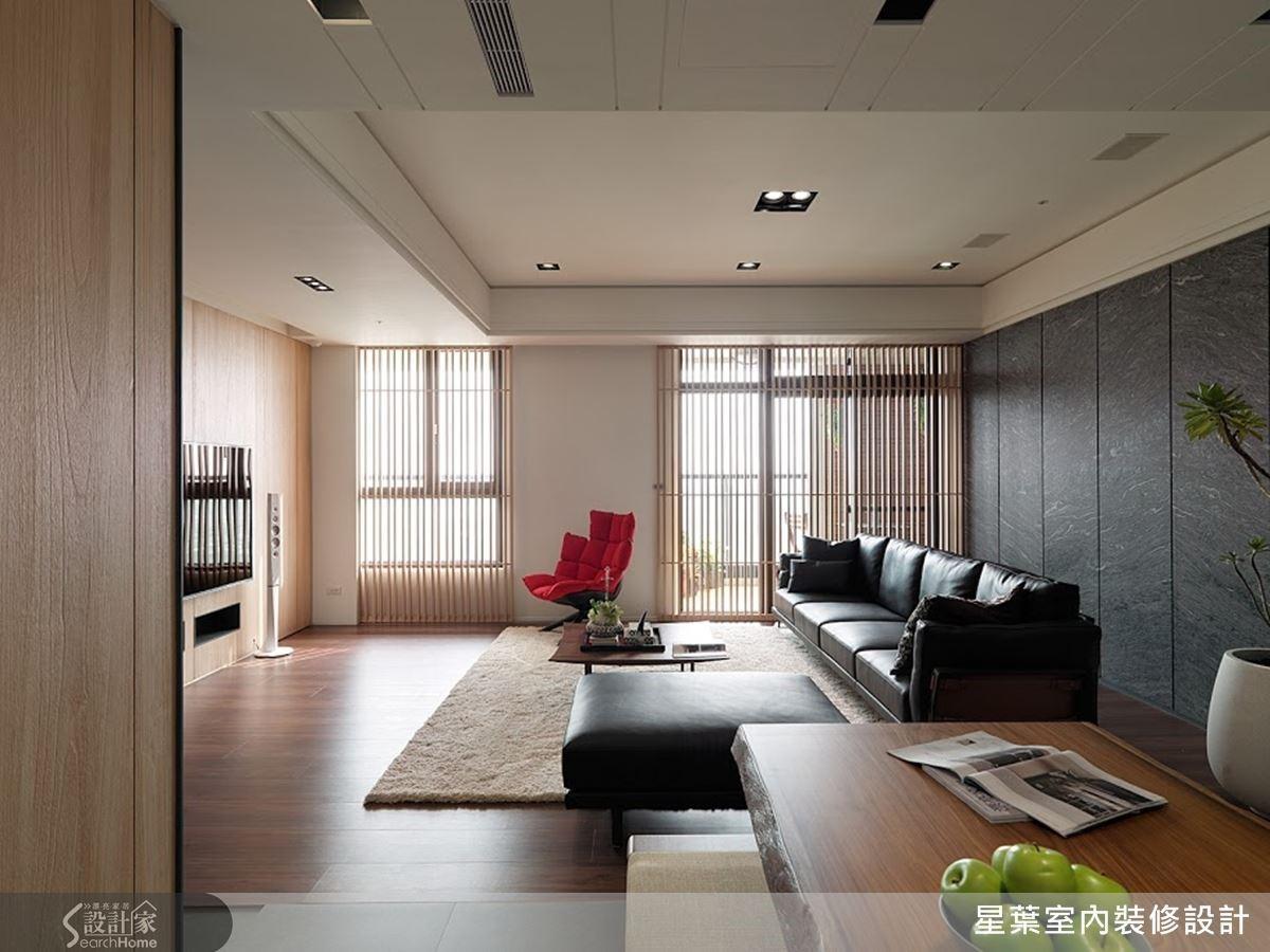 以家具軟件映襯整體空間,顯現低調的名家風範,並點綴一張現代感紅色單椅,構成醒目亮點。