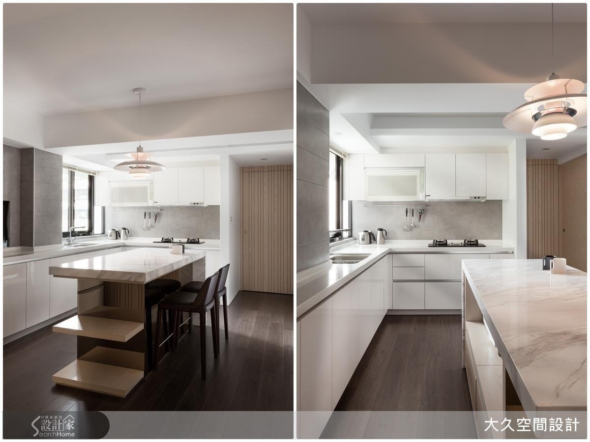 設計師更改原先瑣碎格局,讓餐廚空間成為居家中心,給一家三口零阻礙生活。