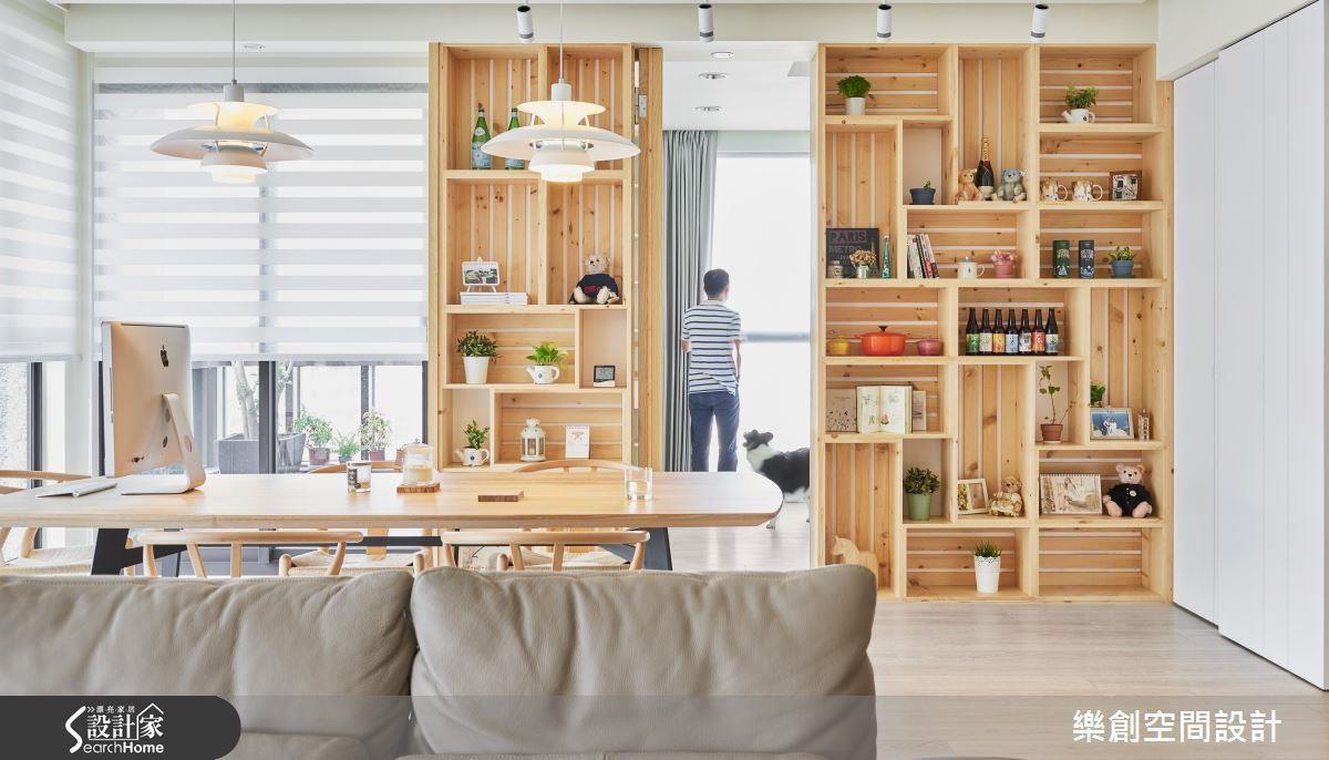 利用木建材在牆面依據各式物品的大小高度,組合成宛如積木的收納,在收納之餘,更創造亮眼端景。