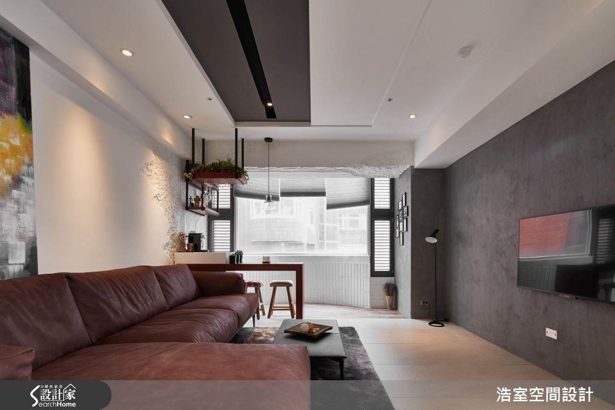 仿清水模質感的電視牆設計,構築出一分自然沉靜的氛圍。