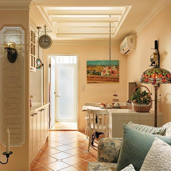 牆面運用文化石和乳膠漆。圖片提供_摩登雅舍室內設計