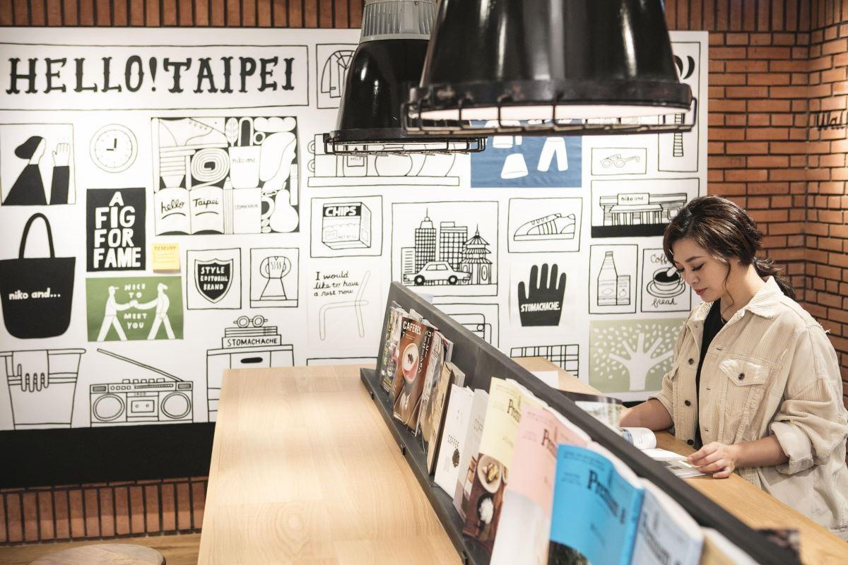 此區域可供飲用咖啡、充電、閱讀及休憩,一旁是插畫家創作的裝置藝術,讓人沉浸在文藝氣息之中。