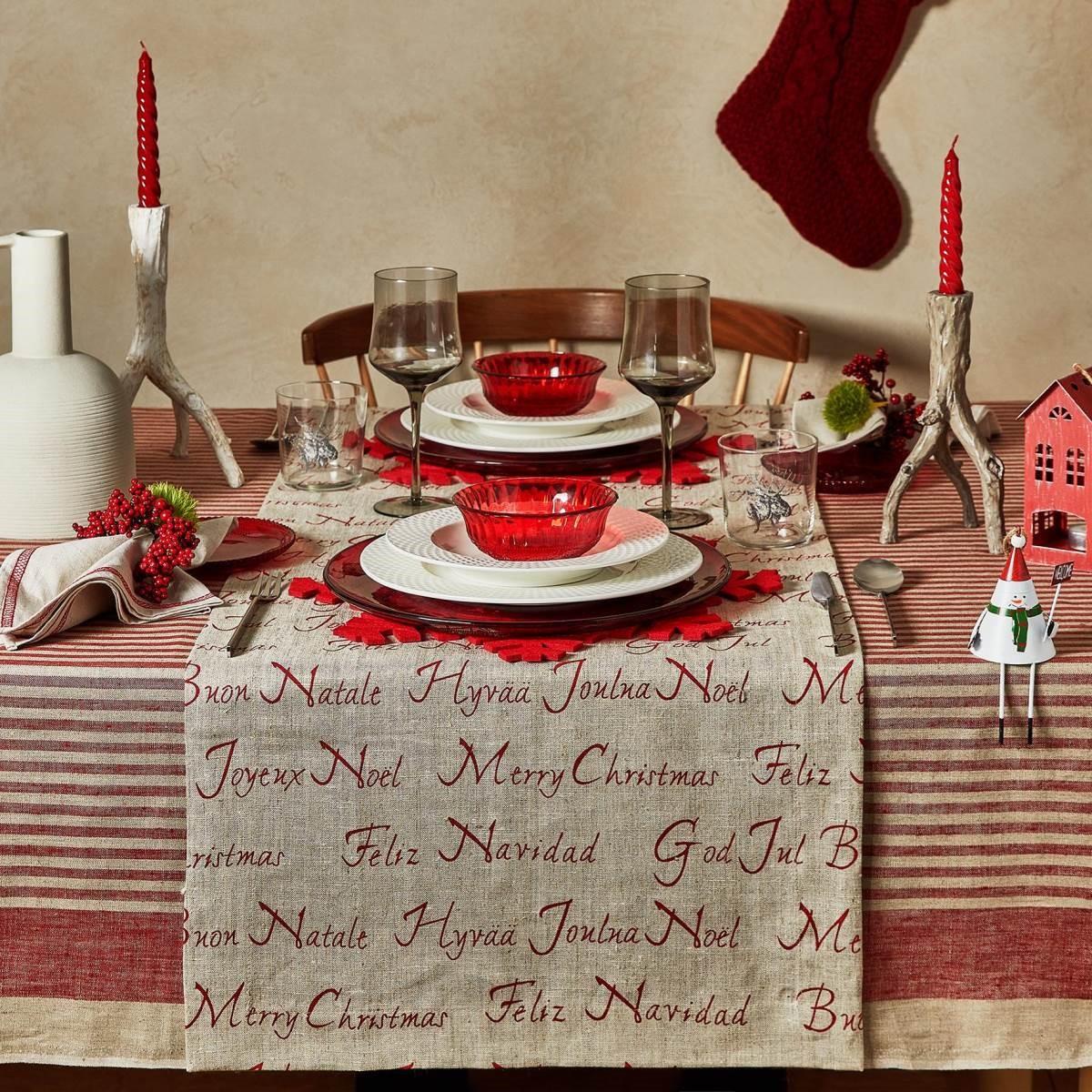 在桌上披上麻質桌巾,運用自然材質強調hygge精神。(圖片提供_Zara Home)