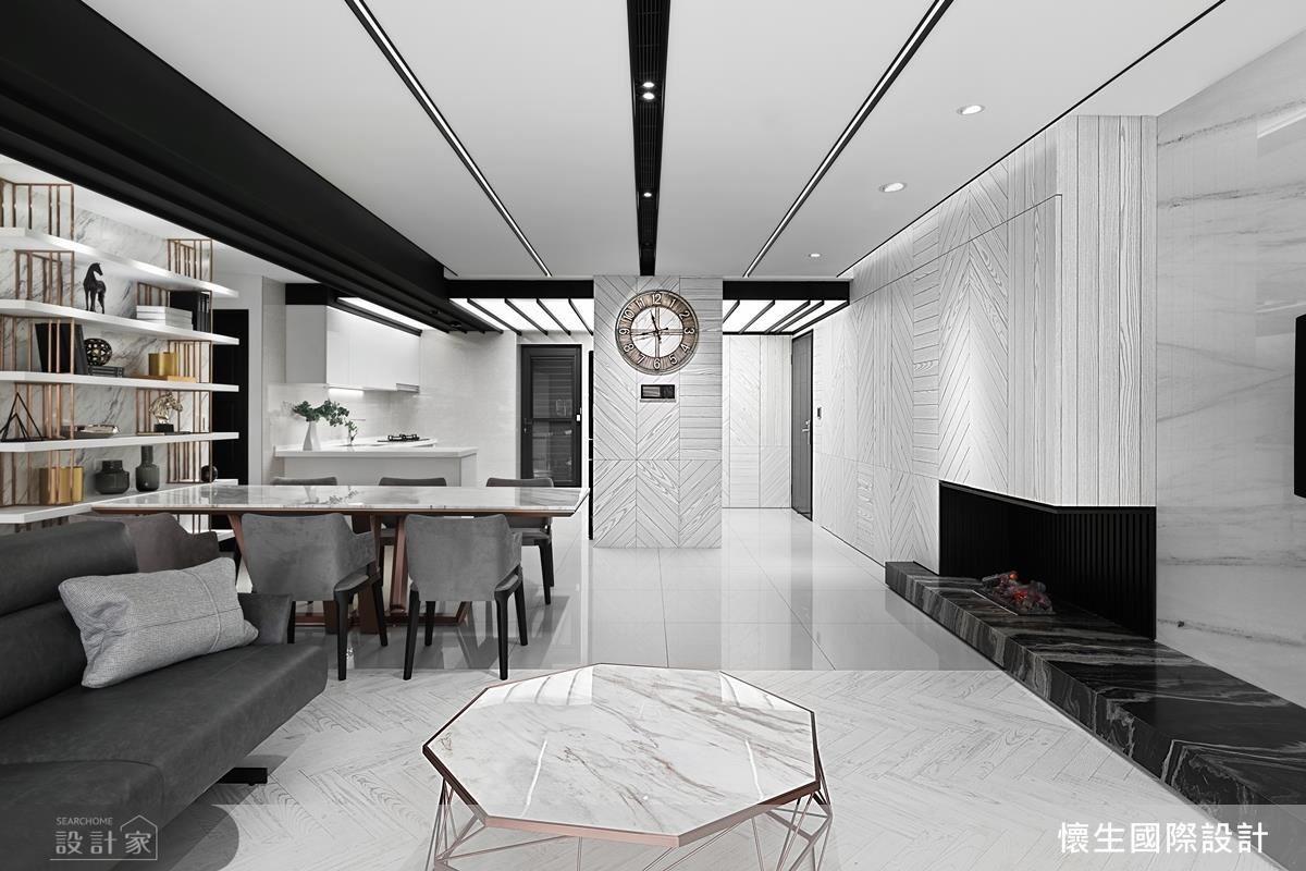 以大面木紋牆面點綴,調和冷硬黑白空間。