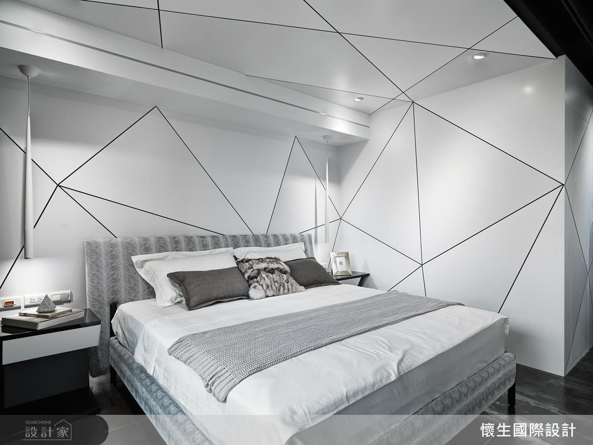 主臥中以線條勾勒出立體牆面,創造出具有個性的前衛空間感。
