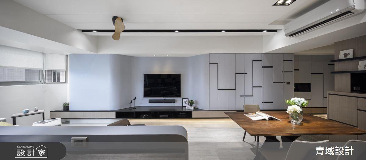 利用弧型包覆後方樑柱,結合收納機能,運用幾何線條勾勒層次感,塑造空間主視覺。