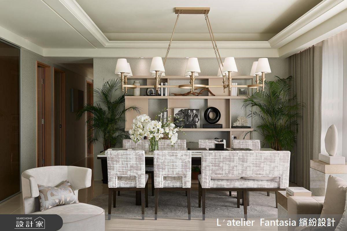 餐廳以毛呢質感壁紙與木皮色彩帶出空間層次,與不規則刷白餐椅相互呼應。