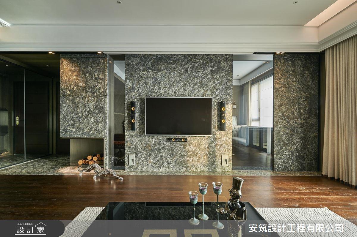 一氣呵成大器牆面串聯起玄關至客廳場域,創造驚艷視覺,也巧妙作為客廳與書房的空間界定。