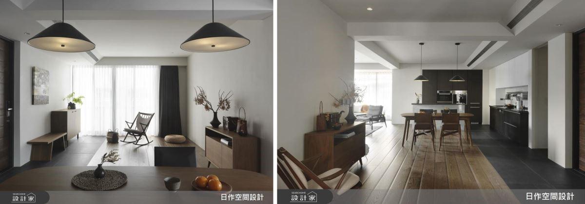 玄關前預留空白牆面做為佈置使用,在深灰地磚與海島木地板的鋪陳下,界定出室內、外的行徑動線。