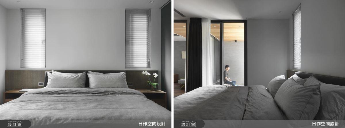 主臥床頭藉兩側小開窗引入光源,並以百葉簾提高起居隱私。一旁通透玻璃拉門則為臥房延攬進陽台景致。