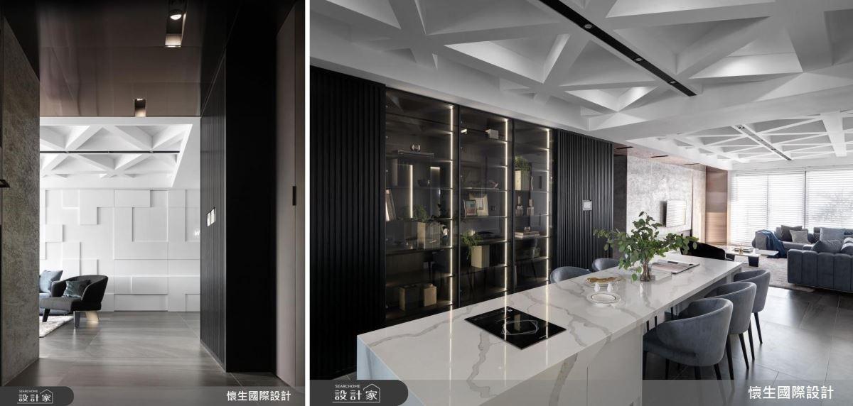 設計師一路從玄關黑色隔柵懸櫃開始延伸到餐廳的黑色餐櫃,創造大面積 L 型收納空間,搭配玻璃材質賦予展示機能。