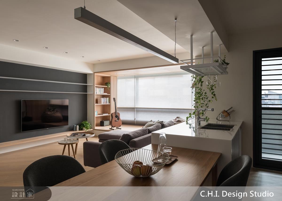 廚房吧檯以植栽吊架設計,為都市生活增添自然綠意。